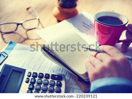 Businessman with Note and Calculator  - stock photo