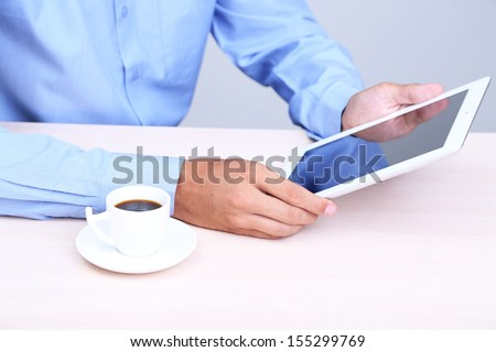 Businessman with notebook in office close-up - stock photo