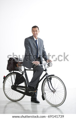 Businessman With Old-Fashioned Bicycle; Concept: I go Green - stock photo