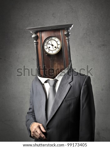 Businessman with old pendulum instead of his head - stock photo
