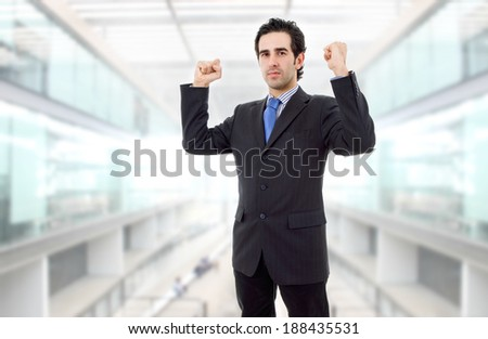 businessman with open arms winning at the office - stock photo