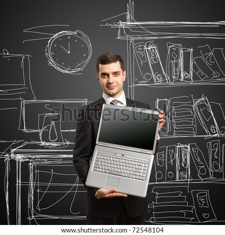 businessman with open laptop in his hands, smiles at camera - stock photo
