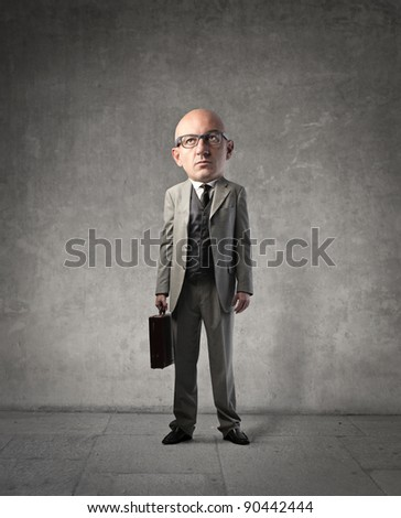 Businessman with oversize head - stock photo