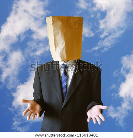 Businessman with paper bag on a head