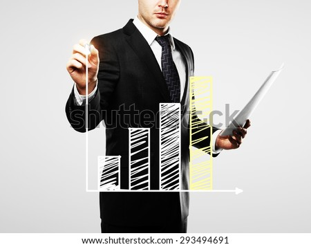businessman with paper in hand drawing chart, close up - stock photo