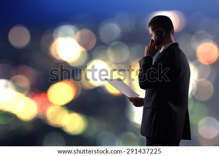 businessman with paper on blured color background - stock photo