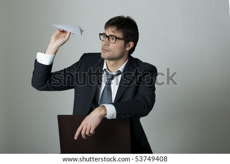 Businessman with paper plane - stock photo