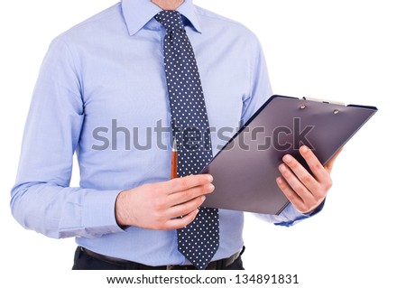 Businessman with pen and clipboard. - stock photo