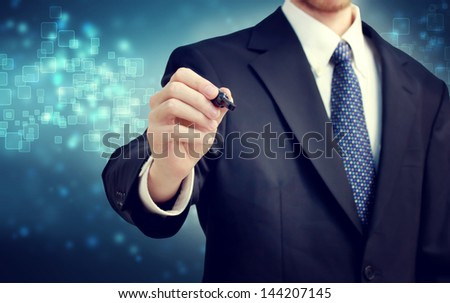 Businessman with pen on shiny blue background - stock photo