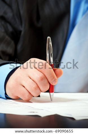 businessman with pen signing contract - stock photo