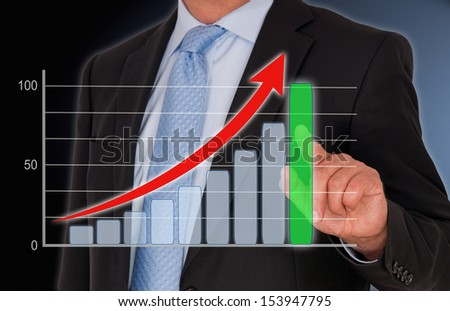 Businessman with Performance Chart - stock photo