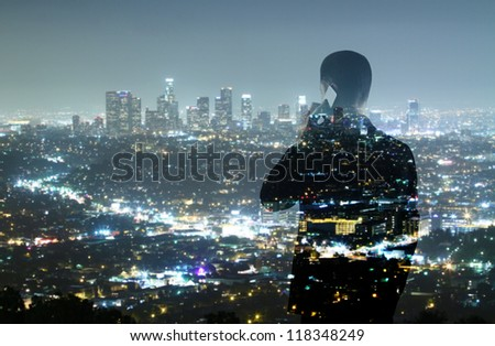 businessman with phone looking in night city - stock photo