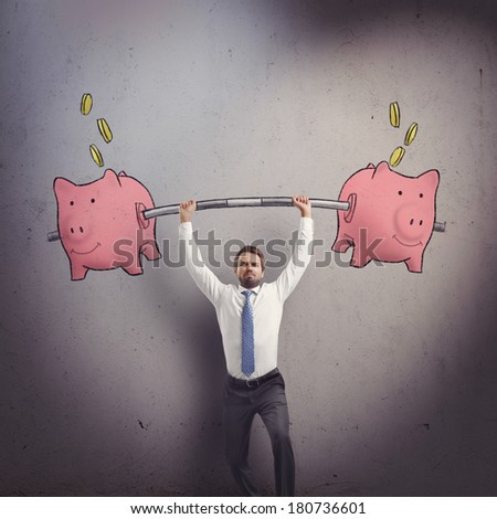 Businessman with piggy banks - stock photo