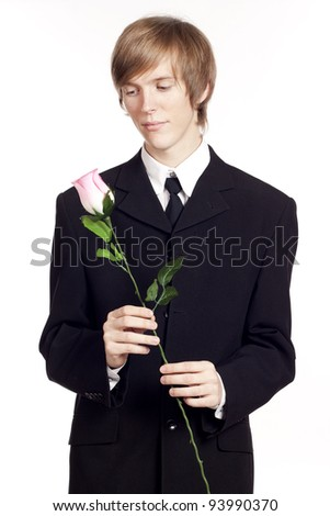 Businessman with pink rose in hand - stock photo