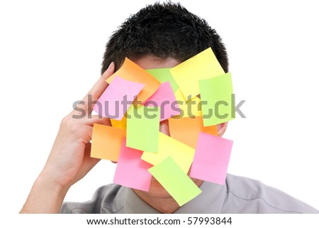 Businessman with plenty of colorful post-it on his face