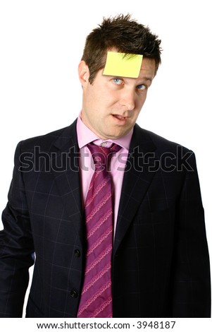 Businessman with post it note stuck onto his forehead as a reminder of work or deadline, isolated. - stock photo