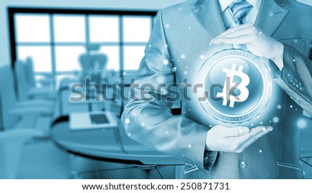 Businessman with protective gesture bitcoins - stock photo