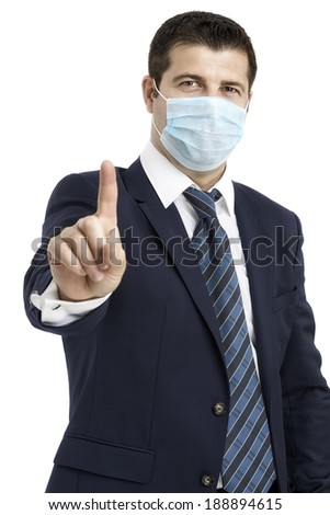 Businessman with protective mask against flu and hand in front, saying Stop! - stock photo