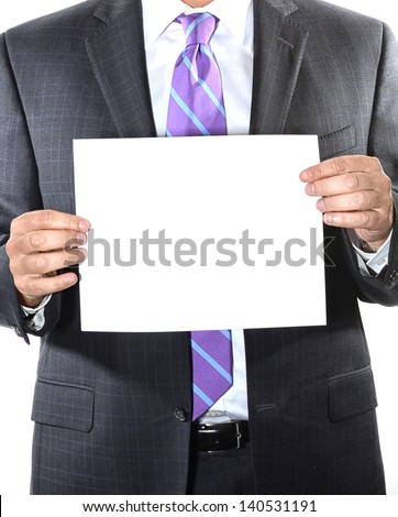 Businessman with purple tie holding a blank sheet of paper - stock photo