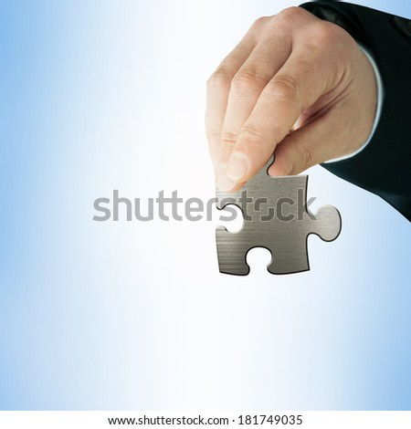 Businessman with  puzzles