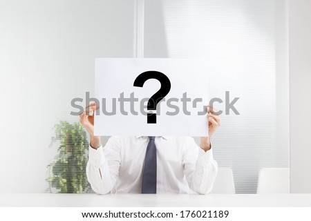 businessman with question mark sign in office  - stock photo