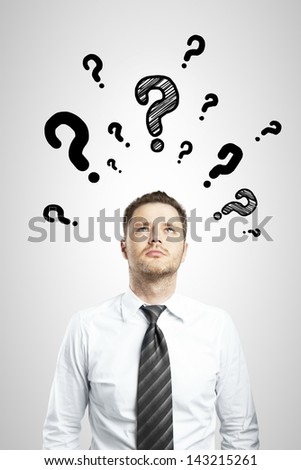 businessman with questions symbol on gray background