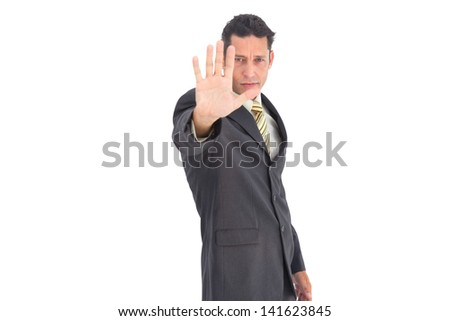 Businessman with raised hand on a white background - stock photo
