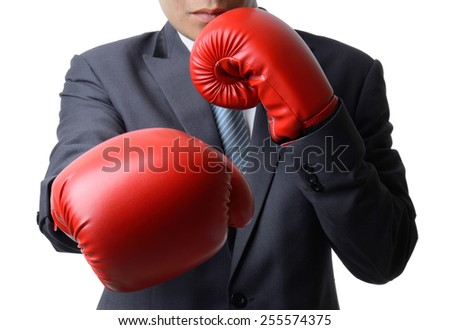 businessman with red boxing glove punch to the goal, business concept - stock photo