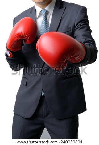 businessman with red boxing glove ready to fight with work, business concept