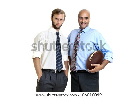Businessman with rugby ball posing - stock photo