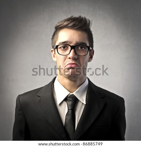 Businessman with sad expression - stock photo