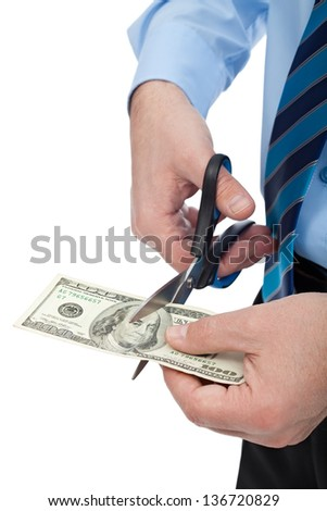 Businessman with scissors ready to cut banknote - stock photo