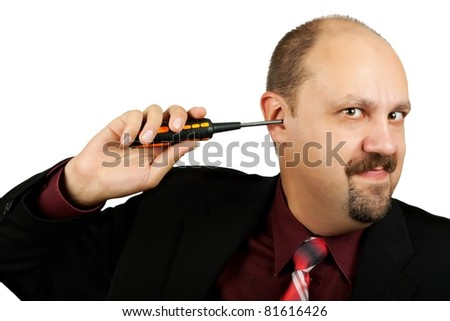Businessman with screwdriver in the ear on white background
