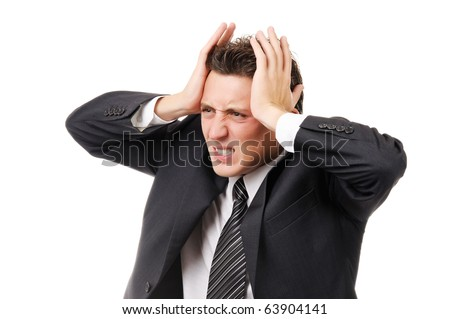 Businessman with severe headache. Isolated on white - stock photo