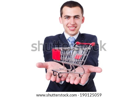 Businessman with shopping cart on white - stock photo