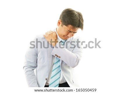 Businessman with shoulder pain.