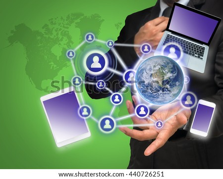 Businessman with show hand posture with the Social media and technology device with world map background,Elements of this image furnished by NASA, Business network concept