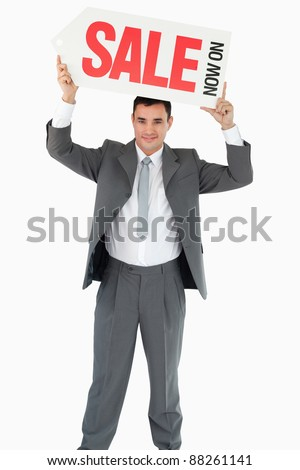 Businessman with sign above his head against a white background