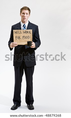 Businessman with sign ill work for food - stock photo