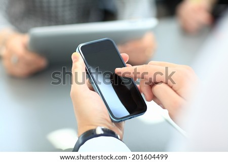 Businessman with smartphone - stock photo