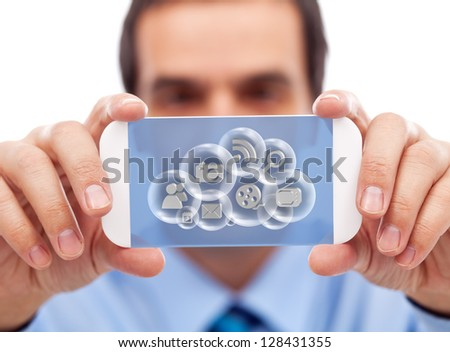 Businessman with smartphone or modern gadget accessing cloud computing applications - stock photo