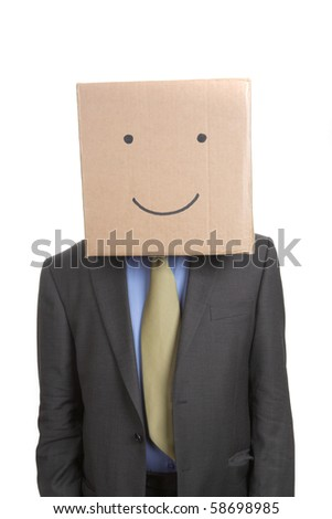 Businessman with smiley face on box - stock photo