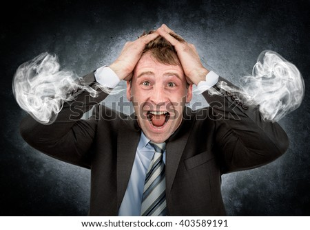 Businessman with smoke coming out of his ears