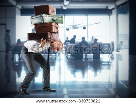 Businessman with so many suitcases inside airport - stock photo