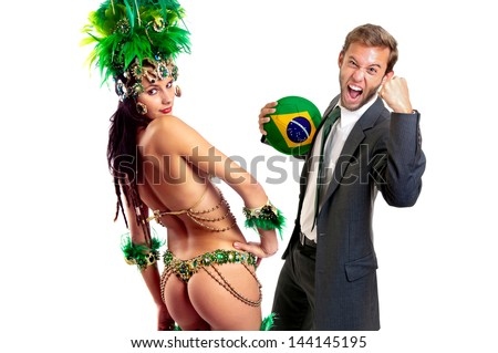 Businessman with soccer ball and brazilian dancer - stock photo