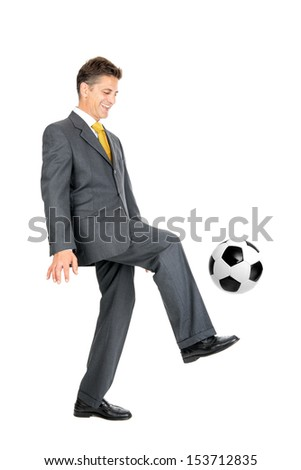 Businessman with soccer ball isolated in white - stock photo