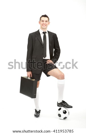 Businessman with soccer kit and ball isolated on white