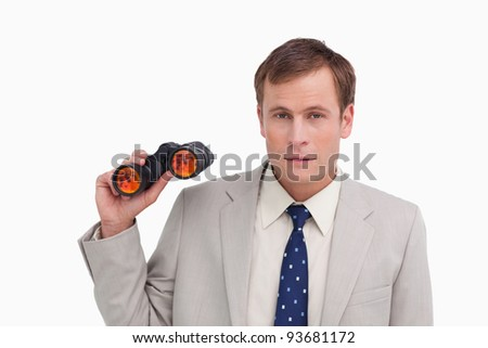 Businessman with spy glasses against a white background - stock photo
