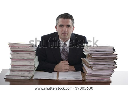 Businessman with stacks of paperwork or files (white background)