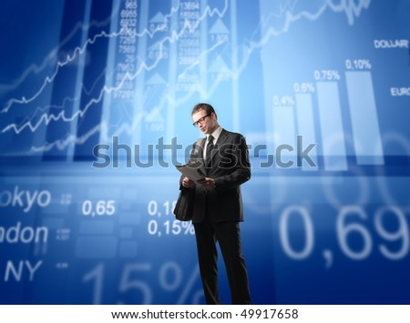 Businessman with statistics and schemes on the background - stock photo